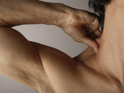 Man pinching his neck