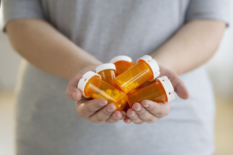 Person holding medication