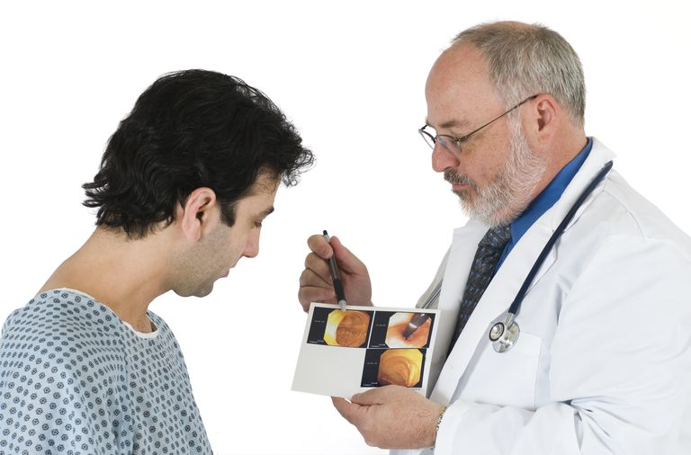 Doctor Explains Colonoscopy Images To Patient