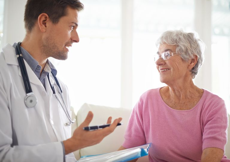 doctor talking to elderly woman