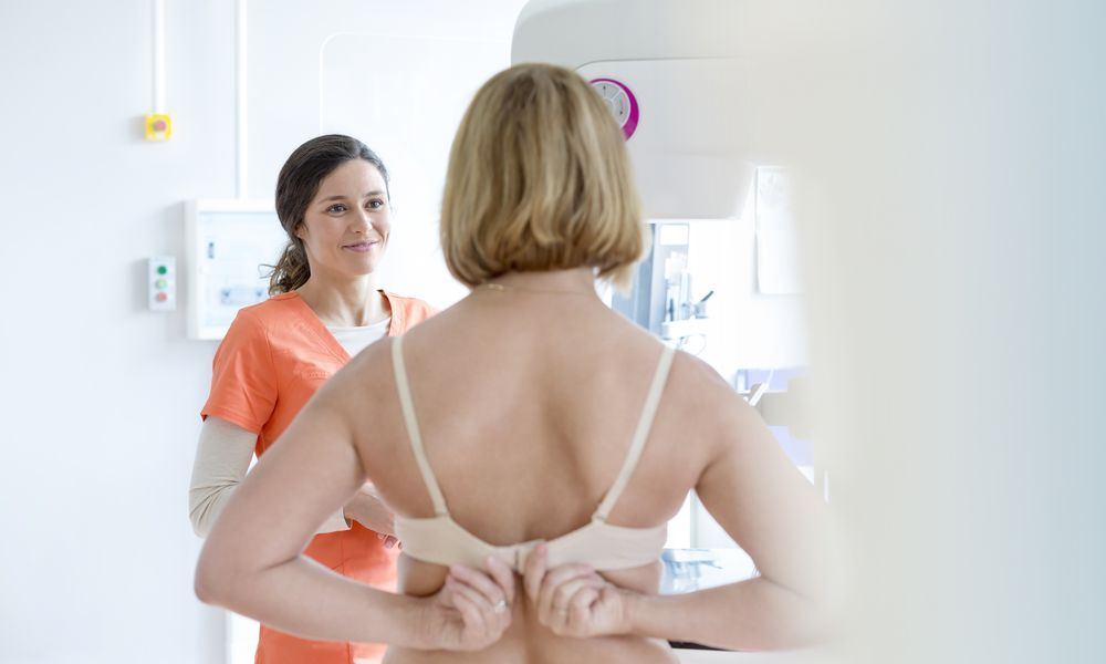 woman taking off bra before mammogram