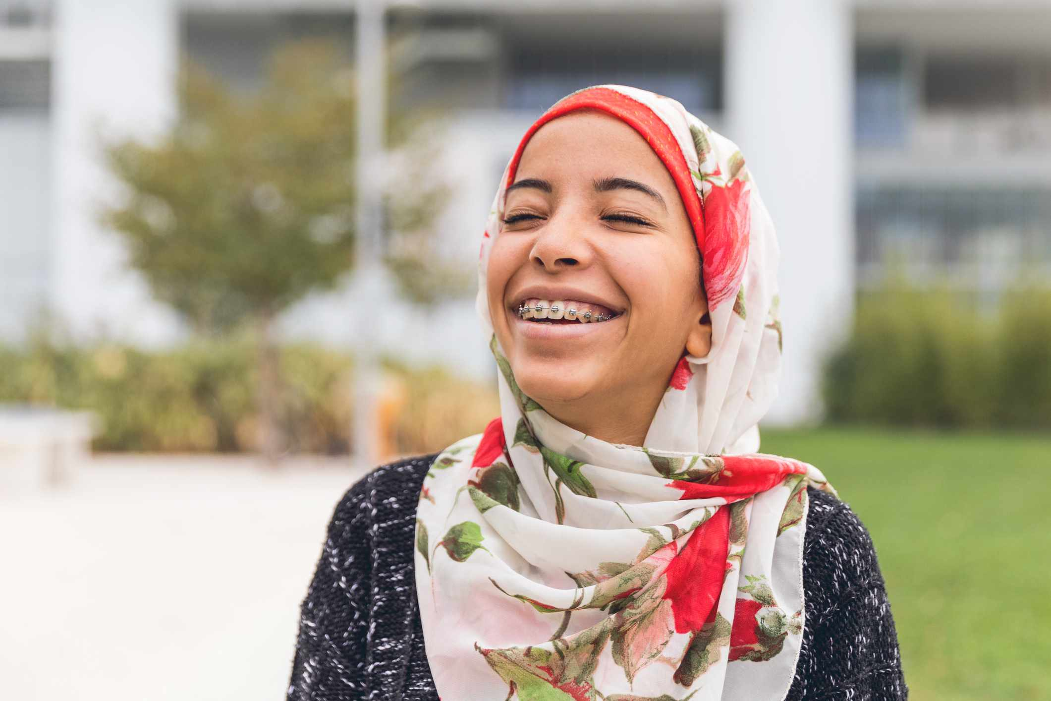 Smiling girl in hijab with braces