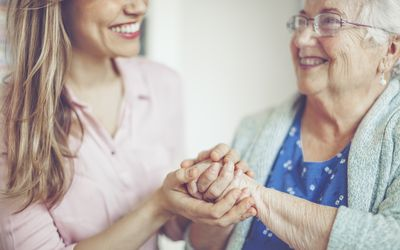 An older woman with her caregiver