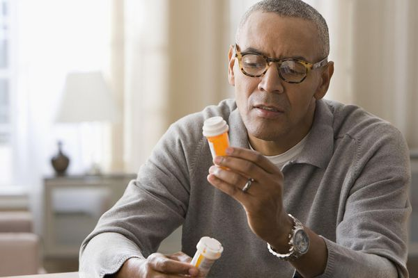 Man comparing medications