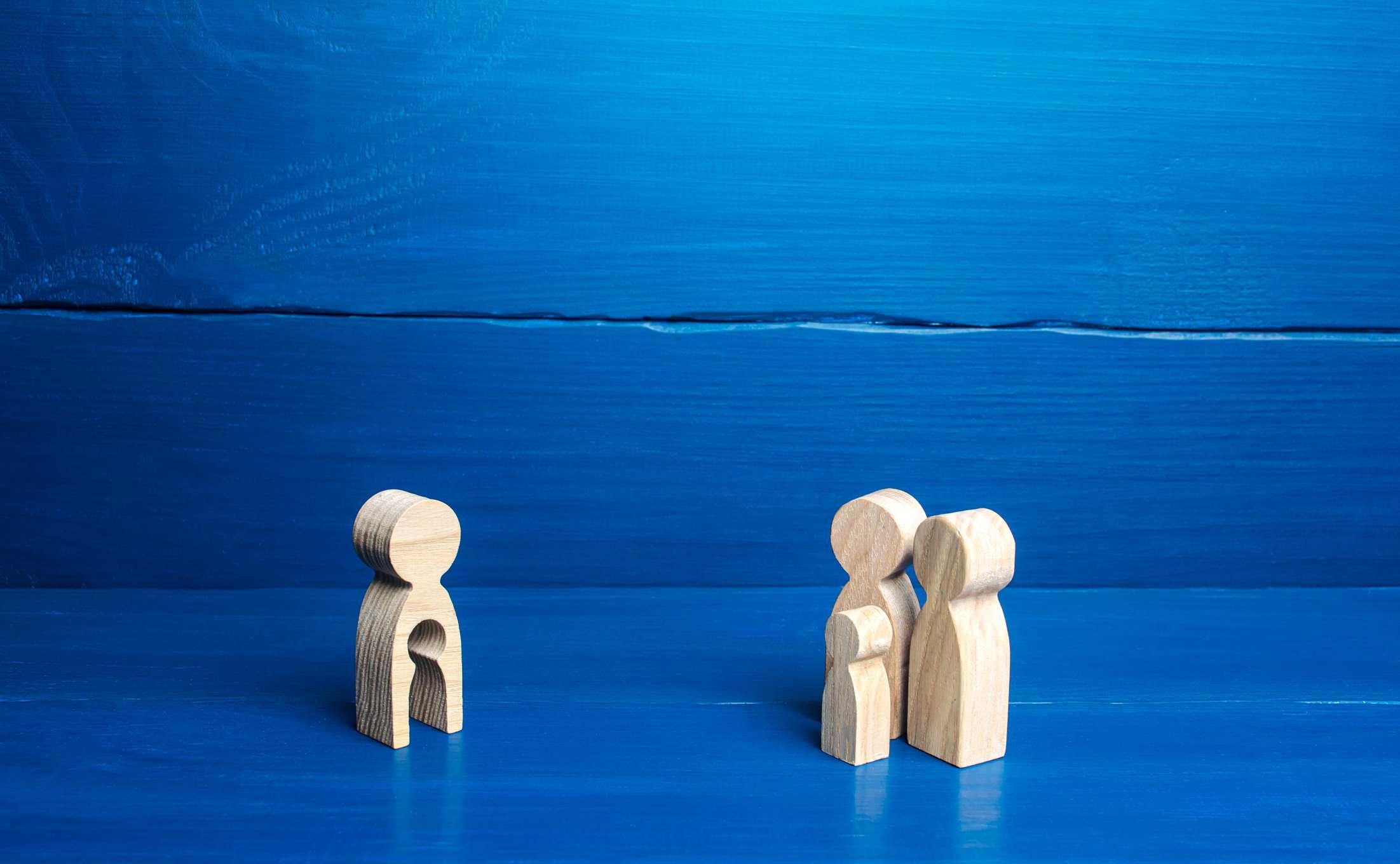 Wooden figurines depict surrogate pregnancy