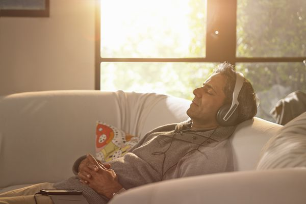 Man relaxing with headphones on