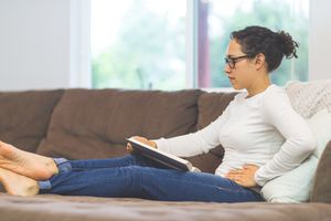 Woman with pelvic pain on couch