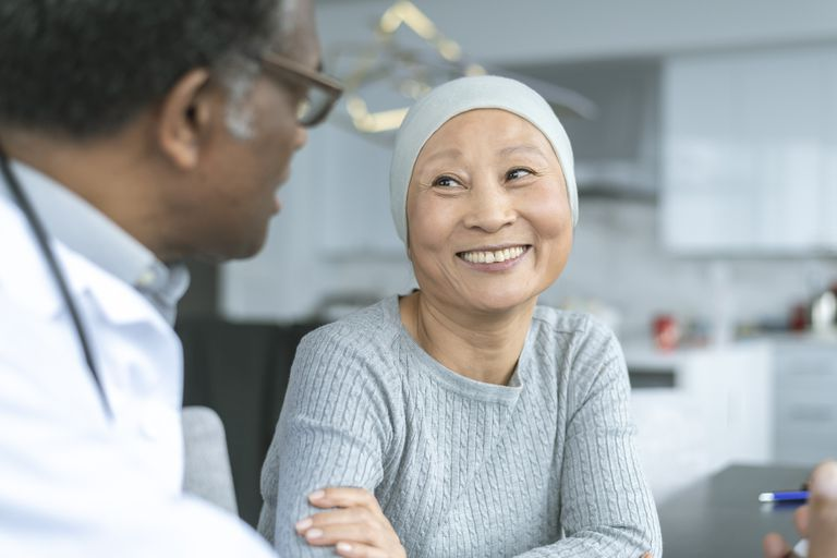 Woman cancer patient talking to her doctor