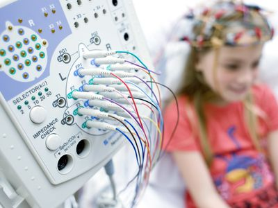 A Young girl hooked up to an EEG machine