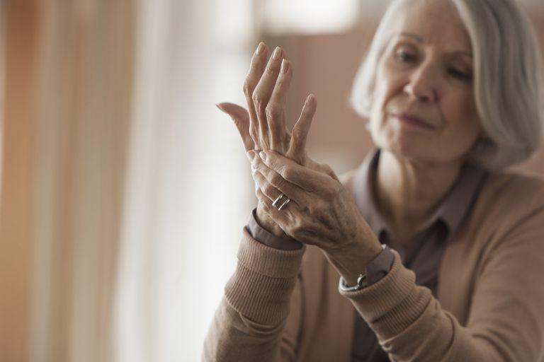 Senior woman rubbing her hands