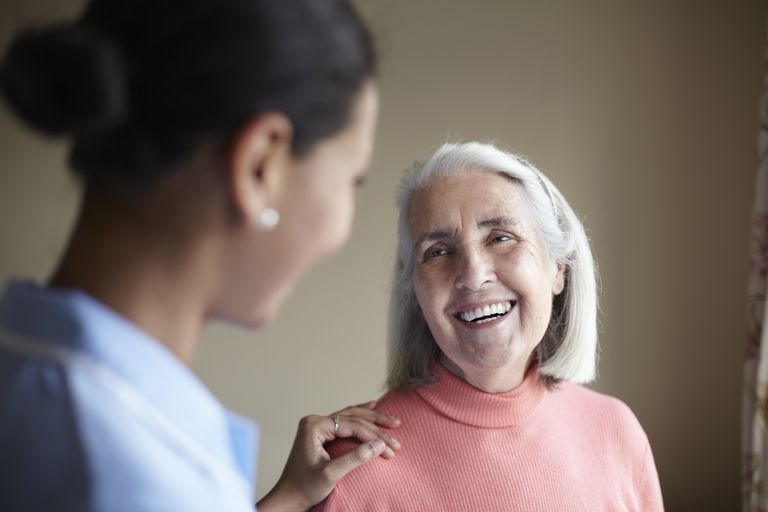 woman smiling with older woman