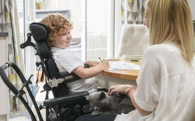 Child at home in a wheelchair