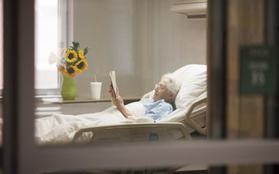 Elderly woman in a hospital bed.