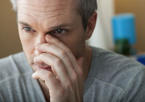Man with sinus problem in his home
