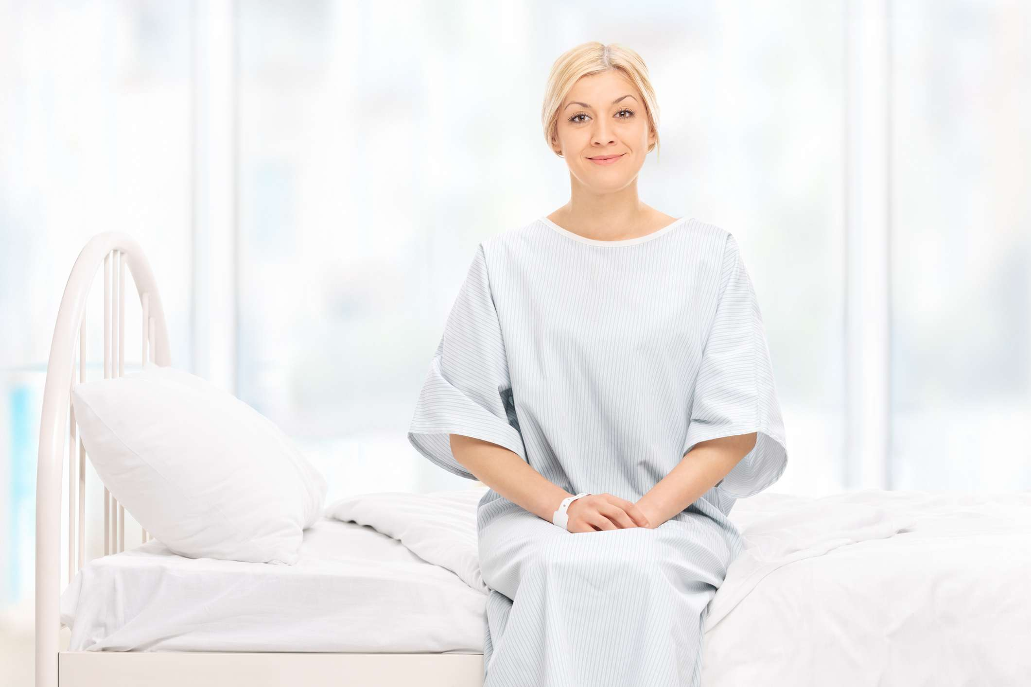 Patient sitting on a hospital bed