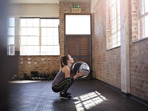 athletic woman squatting