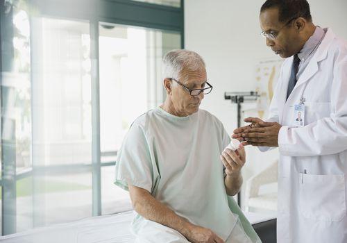 Doctor discussing prescription with senior patient