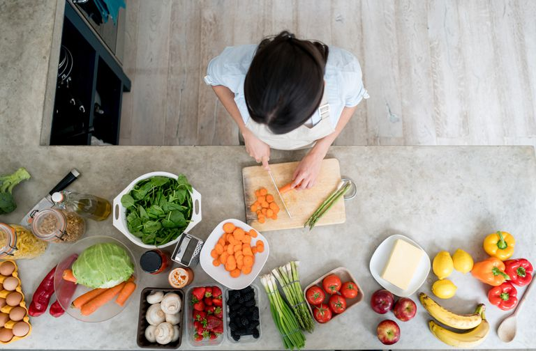 How to keep your heart healthy woman cooking vegetables at home forumfinder Image collections