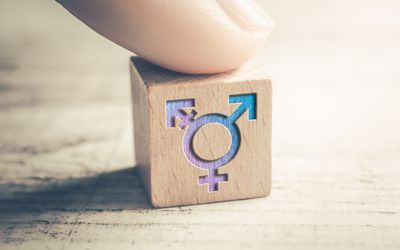 Transgender Icon On A Wooden Block On A Table