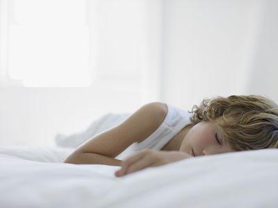 Boy sleeping on bed