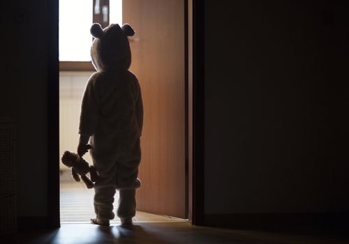 Child in bear costume sleepwalking due to a sleep behavior called a parasomnia