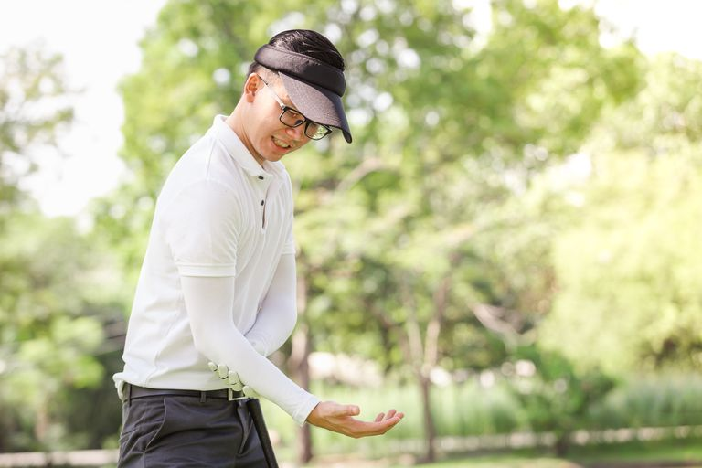 A golfer with pain in his elbow