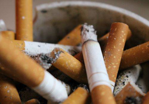 bunch of cigarettes in an ashtray