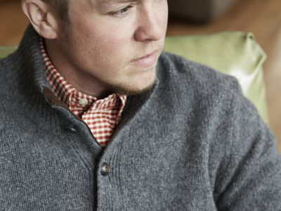 Portrait of a stylish transgender man in living room