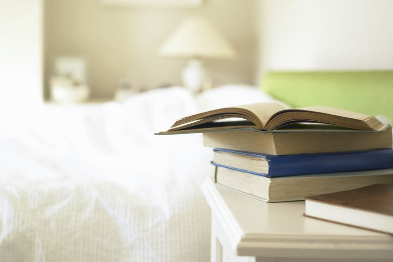 Books on nightstand in bedroom
