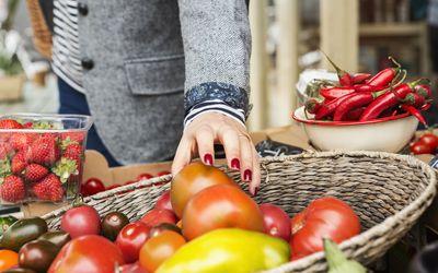 Person Grabbing Fresh Tomato