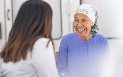 Senior cancer patient talks with her doctor