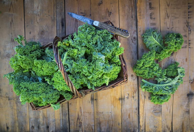 kale in basket and on wooden table