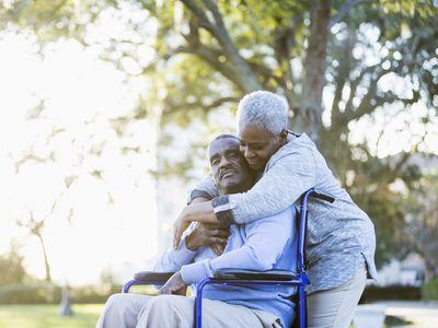 Senior African American couple, man in wheelchair