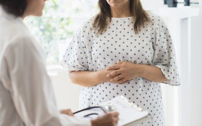 Woman speaking with doctor