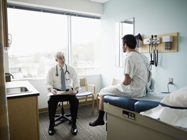 A doctor with his patient on the exam table