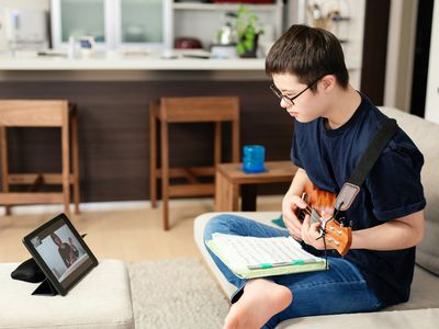 person with Down syndrome participating in online music lesson