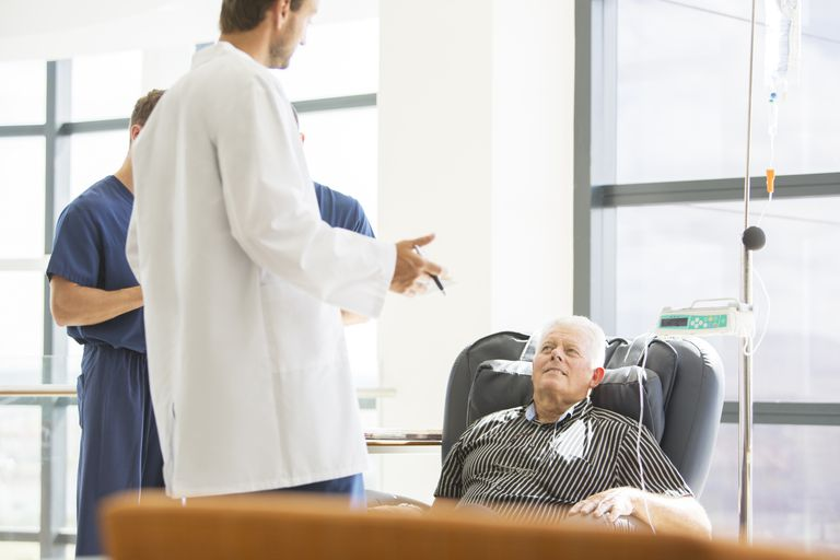 Patient recieving chemotherapy talking to doctor