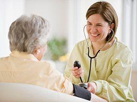 doctor visiting older patient