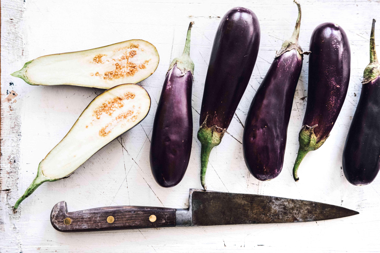 Eggplant, whole and halved