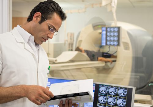 doctor evaluating patient's MRI for lymphoma
