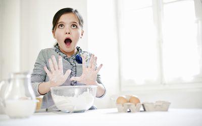 Girl gasping while baking