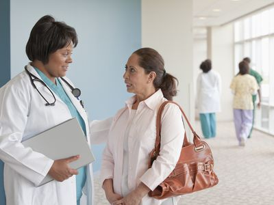 Doctor talking to woman in hospital