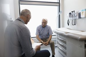 Older man talks to his doctor