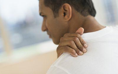 a man holding his shoulder