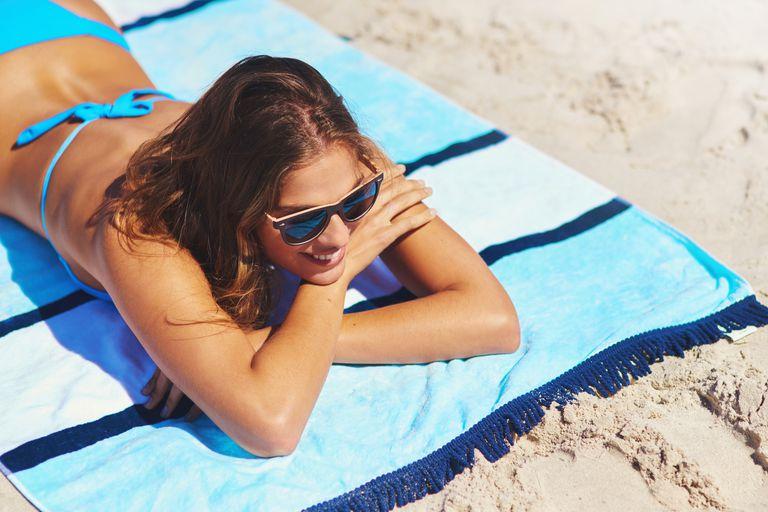 Woman sunbathing at the beach