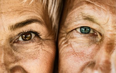 close up of eyes of man and woman