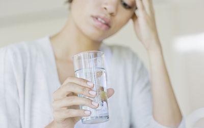 thirsty woman with glass of water