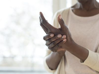 Woman with hand pain - stock photo