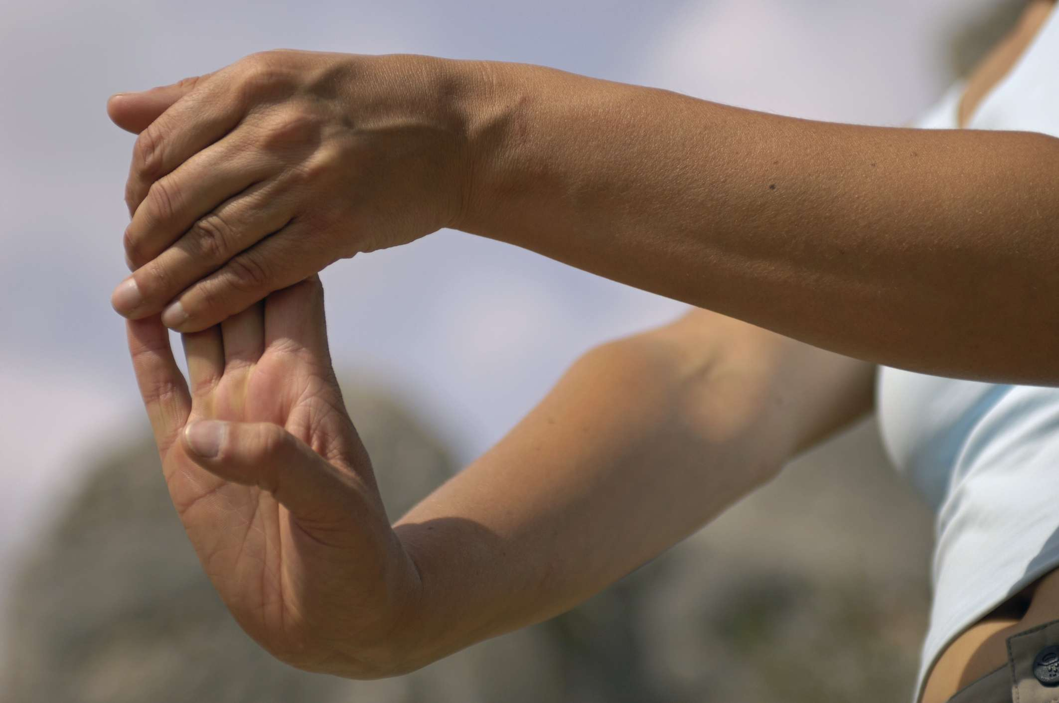 Person stretching fingers
