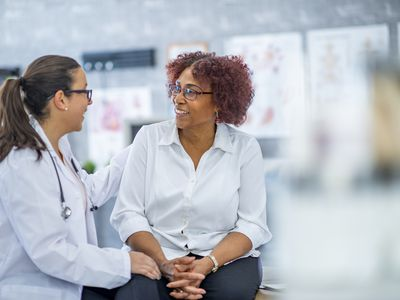 Older woman talking to physician